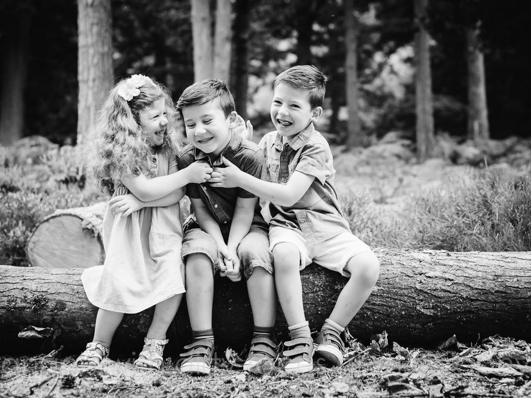 siblings tickle each other in welwyn garden city woods