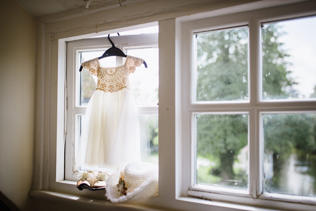 pretty bridesmaid dress hanging in the window