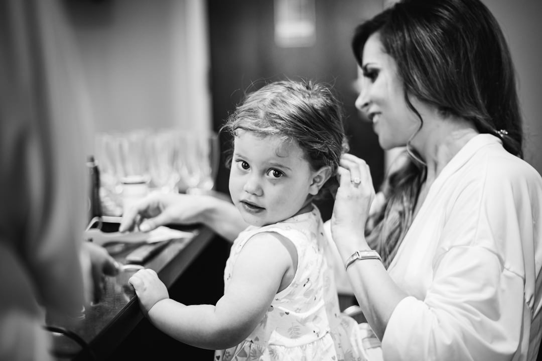 tender moment between bride and her little daughter during bridal prep at their bull hotel gerrards cross wedding