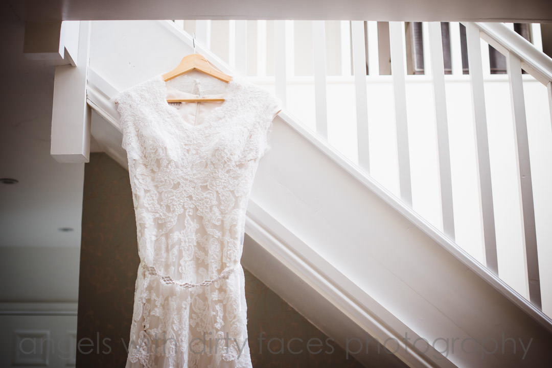 wedding dress hanging on the stairs