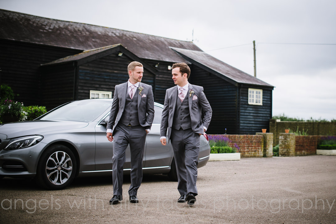 groom and best man arriving at milling barn wedding buntingford