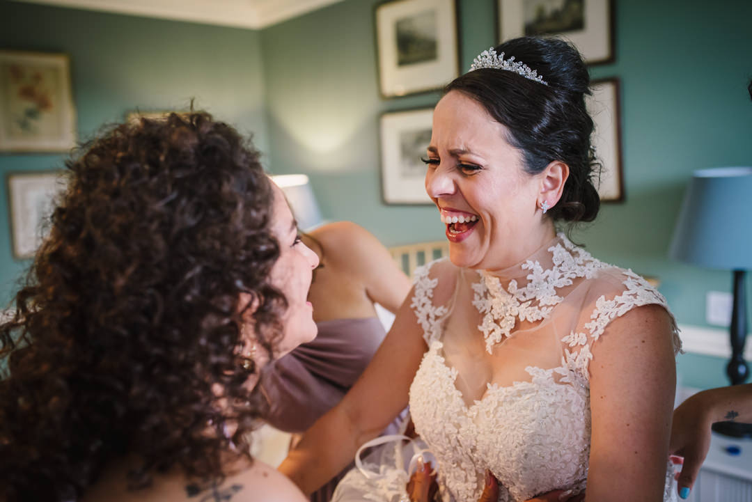 bridal prep jokes between sisters at hatfield house wedding