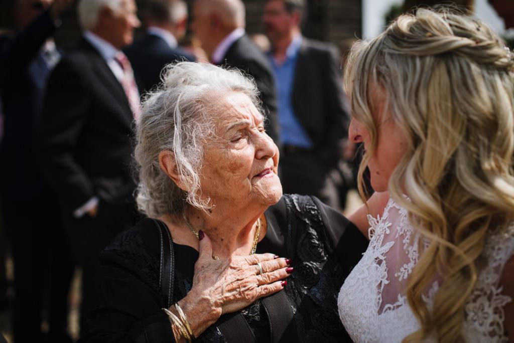 grandmother looking proudly at bride at rowley barn wedding