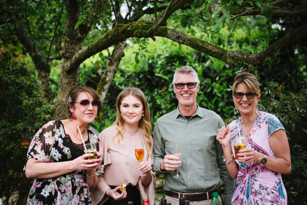 family pose for a photo at hertfordshire garden party