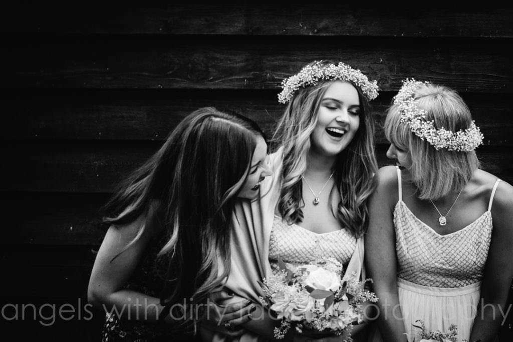 bridesmaids enjoying a joke at hertfordshire wedding