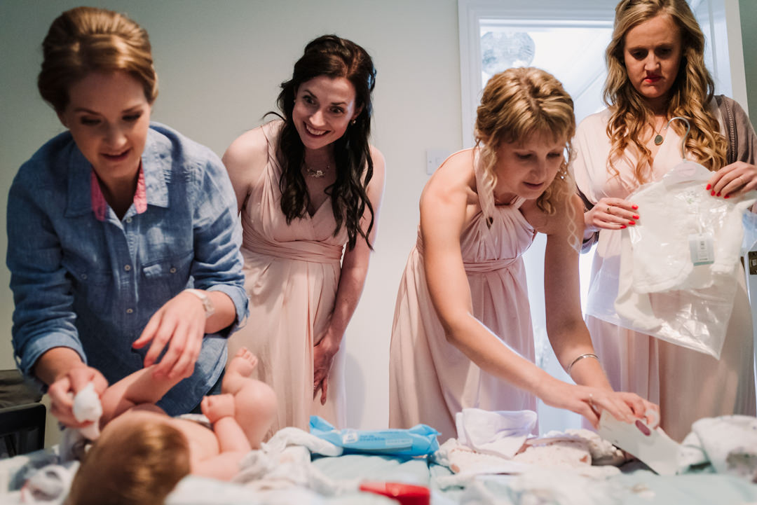 bridesmaids help to get brides baby ready for her harpenden wedding