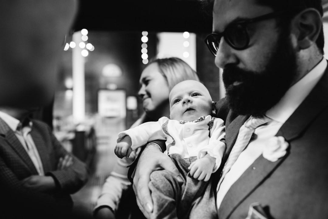 welwyn garden city wedding guests coo over tiny newborn baby