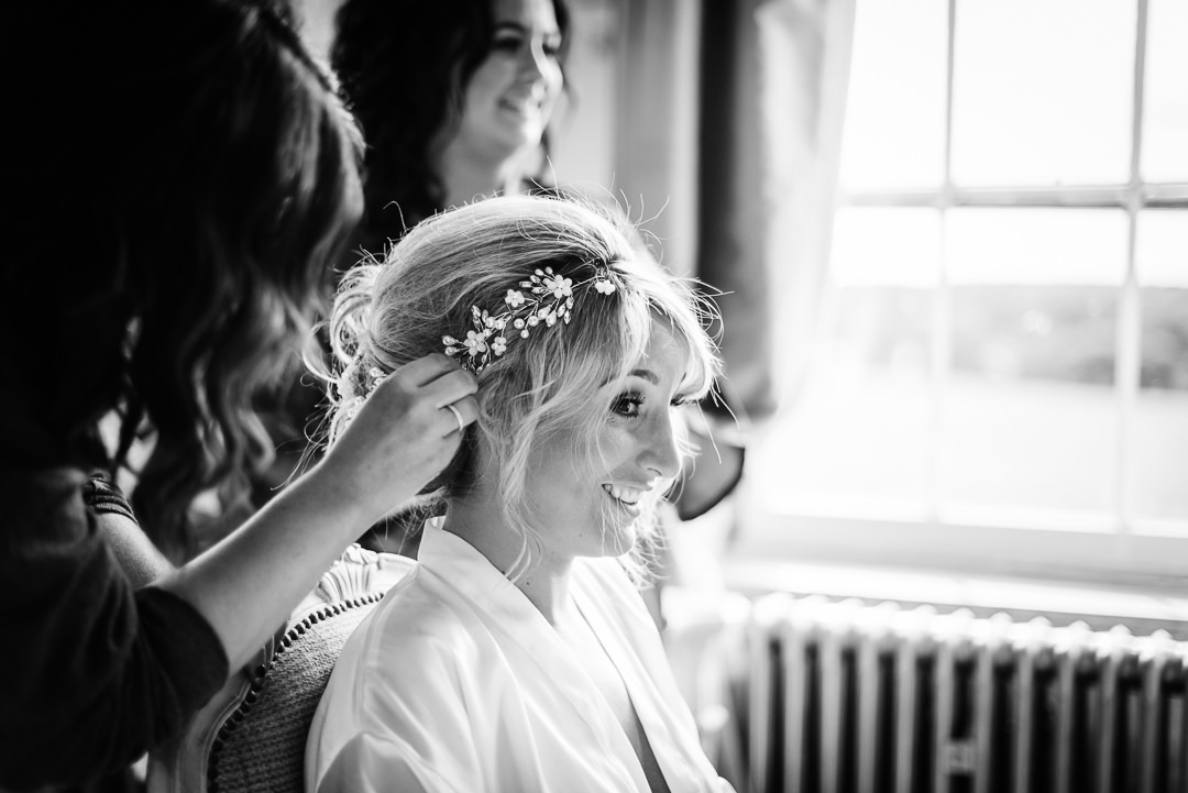black and white photo of bridal preparation at Gosfield Hall wedding