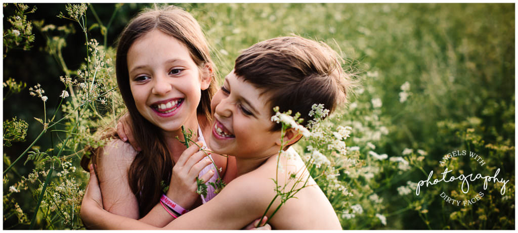 siblings cuddle on their family photography session in Hertfordshire