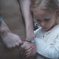 little girl holding her mums hand