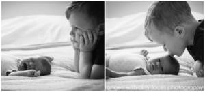 big brother watching his baby sister crying hertfordshire newborn photographer